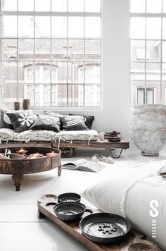 White loft living with amazing windows.