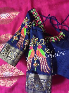 Colorful parrot embroidery design with thread and mirror on designer blouse shoulder. 25 April 2017