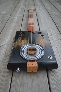 Hey, I found this really awesome Etsy listing at https://www.etsy.com/listing/191546575/cigar-box-guitar