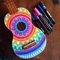 Made to order hand painted ukulele. This listing is for a hand painted ukulele with a brightly coloured dottilism mandala design on the front. Each one will be totally unique and one of a kind piece created on order. Due to a large increase in orders Please allow 3-5 weeks for completion (not including shipping) (Please send me a convo or note if you have any color preferences) The brand of ukulele is Mahalo or Monterey