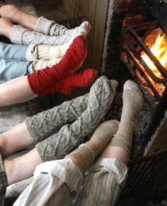 a different angle with all the families feet at the fireplace.