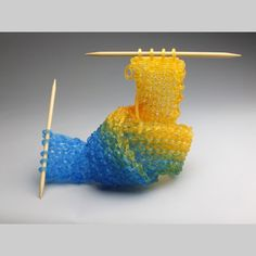"""Knitting with Glass? To look at Carol Milne's glass sculptures is to want to touch them. Milne, of Seattle, has created a line of artwork she calls """"knitted glass. Tricot D'art, Yarn Organization, Knit Art, Crochet Art, Sculpture, Mold Making, Oeuvre D'art, Knitting Yarn, Knitting Needles"""