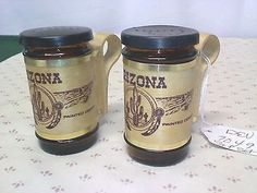 "2 souvenir Pepper shakers, brown glass ""ARIZONA"" kitchen table ware"