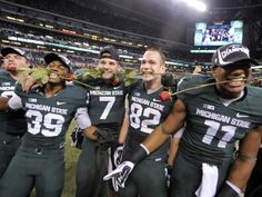 Michigan State celebrate their 34-24 victory over Ohio State in the Big Ten Championship game, Saturday, December 7, 2013, at Lucas Oil Stad...