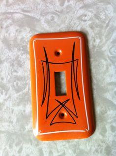 Vintage metal pinstriped light switch cover (orange, black and white). $17.00, via Etsy.