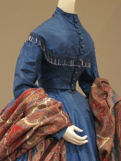 2012-08-25 KSMF -  Blue silk taffeta dress with beaded trim and printed cotton paisley shawl, circa 1870.