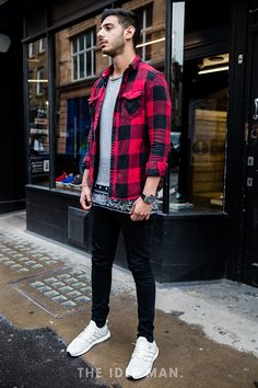 Men's street style | Check you out - You can never go wrong with a pair of black skinny jeans and a longlined t-shirt. Add some fresh trainers and a open checked shirt to have heads turning. | Shop the look at The Idle Man