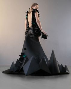 """Paper dress """"cootie catcher"""" based on my sketch, executed by some of my fantastic class mates at ÖFHS. Photo by Cecilia Sandhu, model is Veronica Rönn and the photos were on display at Designarkivet."""