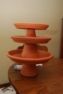 DIY Cake stand... flower pots, flower pot saucers.  Fun idea for serving trays at cookouts?