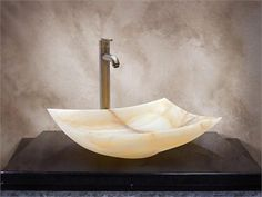 Yosemite Home Decor KAITLYN Stone Onyx 20.25 x 15.75 x 5.5. KAITLYN Yosemite Home Decors Kaitlyn Zen Cut Vessel Sink is made of polished multicolor white onyx stone. This multicolor white onyx vessel sink is essentially hand carved however, the help of some modern tools like small d.. . See More Stone Vessel Sinks at http://www.ourgreatshop.com/Stone-Vessel-Sinks-C710.aspx