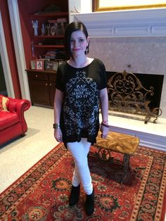 "Skyler has nailed her rocker chic look!  White leather pants, ""rap music made me do it"" hi/lo top by Stylestalker.  Alexander McQueen wide razor blade cuff."