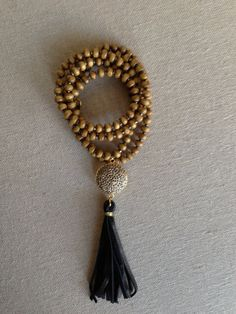 Wood and Pyrite Necklace with Pave Connector and Leather Tassel Pendant by Goldenstrand Jewelry