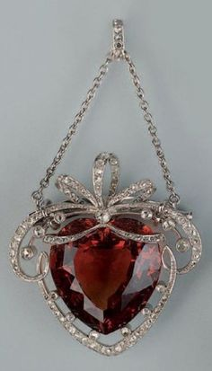 A Belle Epoque white gold, heart-shaped citrine and diamond pendant/brooch, early 20th century. #BelleÉpoque