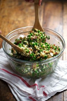 This Spring Quinoa Salad has quinoa tossed with peas, fresh herbs, feta, bacon, and almonds, plus a homemade Honey Lemon Vinaigrette. OH YES.  | pinchofyum.com