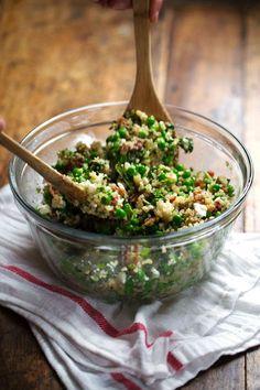 This Spring Quinoa Salad has quinoa tossed with peas, fresh herbs, feta, bacon, and almonds, plus a homemade Honey Lemon Vinaigrette. OH YES.  | pinchofyum.com
