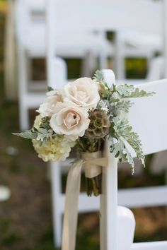 White roses and hydrangeas make beautiful aisle markers for your wedding ceremony. {Rennard Photography}