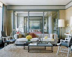 Have two skinny coffee tables instead of one large one--stagger them    Thom Filicia