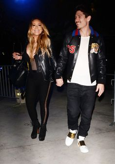 Mariah Carey Blushes While Singing Along to Her Own Song at Clippers Game Shows PDA With