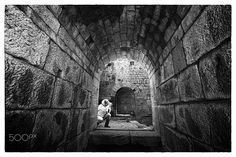 corridors of pergamon - a photographer in the corridors under the temple of trajan in the ancient city of pergamon-a unesco heritage site in the agean turkey near izmir