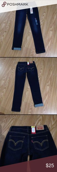 Levi's crop supper skinny jeans New with tags, newer worn, Levi's 535 cropped super skinny dark denim with gold stitching, purchased too small, 25 waist, 26 inseam levis Jeans Skinny
