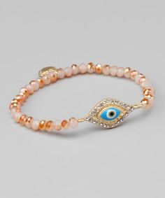 I don't know what it is. But I'm obsessed with the eye. Take a look at this Coral Crystal & Gold Protect Stretch Bracelet by Tammy Spice Jewelry on #zulily today!