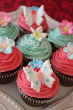 Pretty cupcakes decorated with butterflies and flowers.