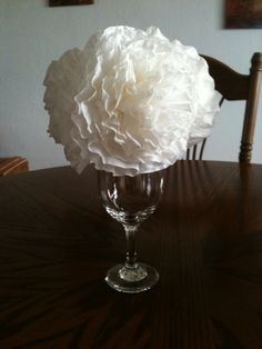 I made these flowers out of coffee filters. Very easy and inexpensive to make. I'm thinking about using these for centerpieces for a bridal shower I will host in April.