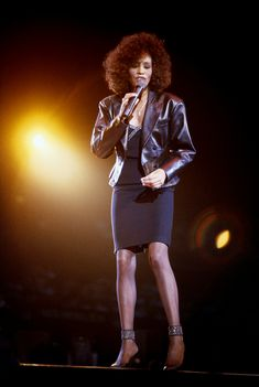 Whitney Houston performs on stage at Wembley Arena, London, October 1987.