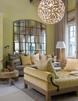 obsessed with the circular lighting fixture and the mirrored wall in this half of the barry dixon show house room.