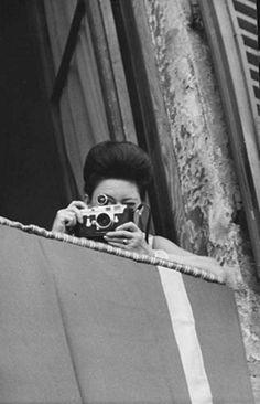 Princess Margaret taking a photograph.