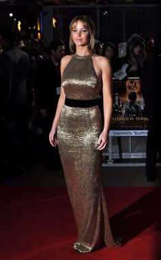 Jennifer Lawrence wearing a custom made Ralph Lauren dress at the London premiere of The Hunger Games, March 14th