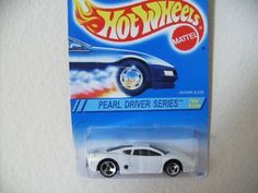 Mattel Hot Wheels 1994 Pearl Driver Series #4 Jaguar XJ220 by Mattel. $0.01. 1:64 Scale Die Cast Metal - Collector #296. Pearl Driver Series - Jaguar XJ220 - White. 1994 - Mattel - Hot Wheels - Rare Wheel Variation. New - Mint - Rare - Limited Edition - Collectible. Out of Production - Collector Perfect. 1994 - Mattel - Hot Wheels - Pearl Driver Series - Jaguar XJ220 - White - Rare Wheel Variation - 1:64 Scale Die Cast Metal - Collector #296 - MOC - Item #1328...