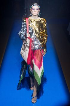 <p>Inspired by legends such as Elton John and Bob Mackie it's no wonder why Gucci's 2018 Spring Collection was a blast from the past.Glaring midi dresses, snazzy quilted skirts and flagrant neckwear lit up the runway during this highly anticipated debut. Gucci imprinted rubber hand bags, crafted animal head rings and lime leather dresses all…</p>
