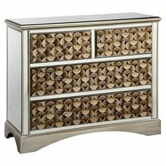 """4-drawer wood chest with raised geometric facings and mirrored panels.   Product: ChestConstruction Material: Wood and mirrored glassColor: Gold, white and blackFeatures:  Mirrored panelsFour drawersGeometric facings Dimensions: 35.5"""" H x 39"""" W x 16.5"""" DCleaning and Care: Wipe with clean soft cloth"""