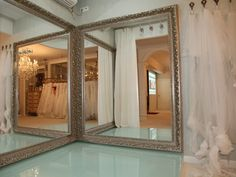 Love the corner mirror design.  Don't think I can pull this off in my boutique floor plan. Love the veils display!