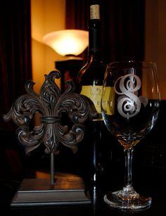 Etched Fleur de Lis Wine Glasses with Initials. $10.00, via Etsy.