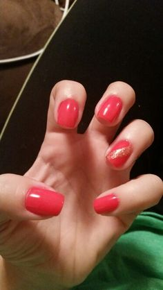 Tiger Blossom coral color by Gelish. Gold Glitter stripe by Sensationail.