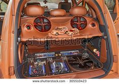 """CESENATICO, ITALY - JULY 12: Trunk of a customized Chrysler PT Cruiser with power music audio system exhibited at tuning car rally """"Cesenatico tuning day"""" on July 12, 2015 in Cesenatico, Italy  - stock photo"""