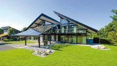 Moderne energieeffiziente Fachwerk-Häuser aus Holz und Glas - HUF HAUS