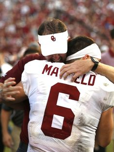 Oklahoma coach Lincoln Riley and quarterback Baker Mayfield (6) embrace  following the team s 29-24 win over Texas in an NCAA college football game  Saturday 3c9bb8673
