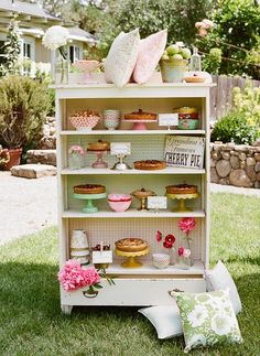 Shabby chic vintage dresser transformed into a dessert buffet at a summer party
