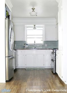 Crown Molding across the top of the soffet, white cabinets, with aqua / green / grey tile backsplash