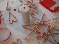"""Start by gluing together the """"heart"""" shapes. Let dry, then layer them up. Finish off with mini silver bells."""