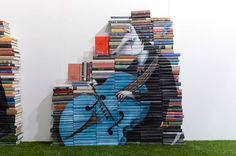 Mike Stilkey's whimsical sculptural book paintings