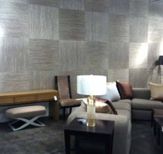 Large-scale squares of striated grasscloth create a subtle, sophisticated checkerboard effect.