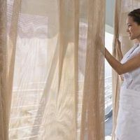 Curtains can be used for many purposes, from covering a window or blank wall, to a room divider to add privacy and character to an otherwise wide-open space. When hanging a curtain room divider from a drop ceiling, curtains can be hung in a number of ways, including hanging curtain rods, a pulley system or curtain track system. Installing a track...