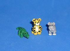 Polymer Clay IttyBitty Crocodile, Cheetah, or Hippo. $6.00, via Etsy.