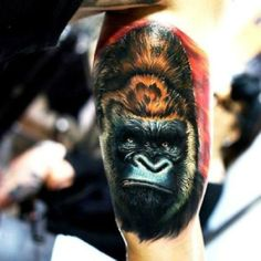 Gorilla Tattoo - I don't know who the artist is for this tattoo, but it's amazing. I actually had to look twiceat the face, to make sure it was a tattoo and not a photograph.