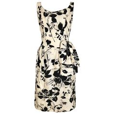 1960s Black and Ivory Floral Print Sleeveless Silk Sheath Vintage 60s Dress   From a collection of rare vintage day-dresses at https://www.1stdibs.com/fashion/clothing/day-dresses/