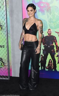 Leather look: Singer Kehlani flashed her midriff in a black bra top and leather flares